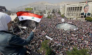Mass demonstration in support of Syria's secular Arab nationalist government, 2011.